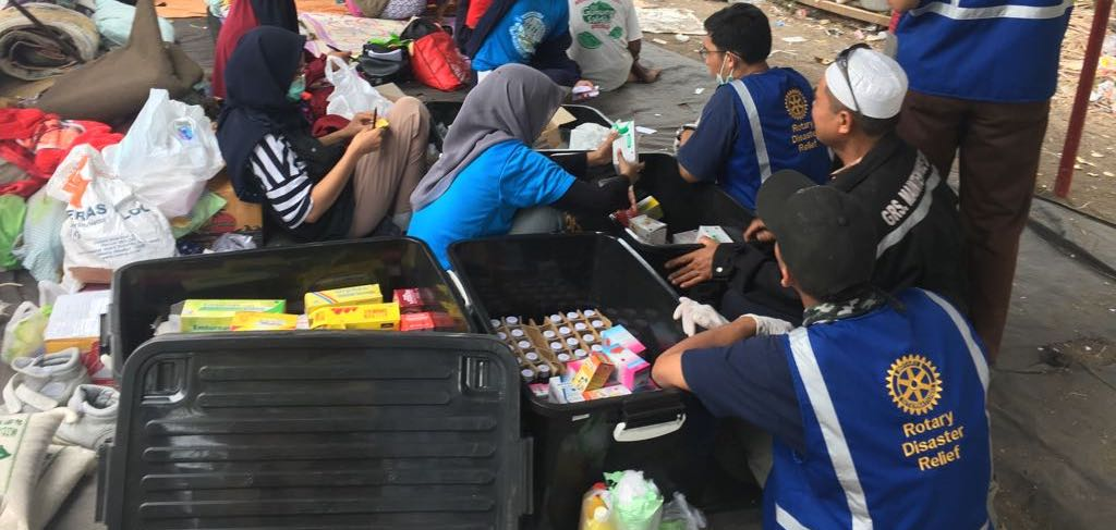 Rotary Disaster Relief Team disbursing supplies