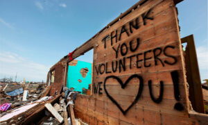 Construction site with words written on wall THANK YOU VOLUNTEERS - WE