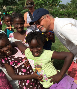 Tim Madden with Haitian Children