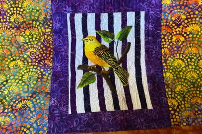 embroidered yellow bird